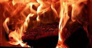 4k fireplace burning wood fire stove macro slider shot stock