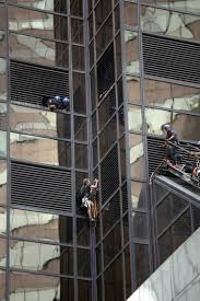 see it donald supporter scales trump tower with suction cups ny