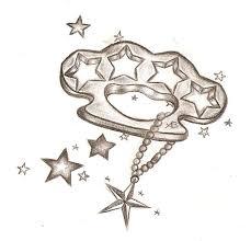 brass knuckles and star tattoo ideas tattoomagz