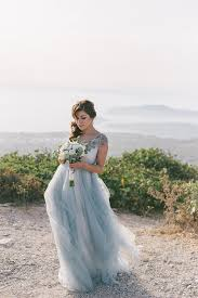 dusty wedding dress intimate dusty blue wedding in santorini chic stylish weddings