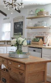 brick backsplash wood island open shelving love this kitchen