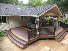 trex deck with hip roof and grill bump out amazing decks