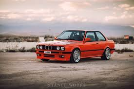 bmw e30 stanced div u003erestoring glory u2013 the h u0026r feurorange bmw e30 318is u003c div
