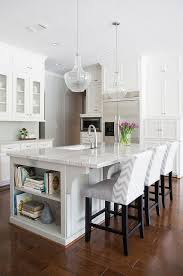 white and gray kitchen features white cabinets paired with new