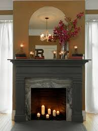 interior dark fireplace mantels with sconces and flowers vase