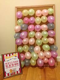 balloon darts carnival game use card board in place of cork board