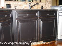 How To Distress White Kitchen Cabinets Painted Kitchen Cabinets Mediterranean Kitchen Charlotte
