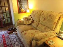 An Armchair Camden Floral Wheat Manual Recliner Two Seater Sofa And An