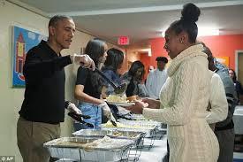 barack obama and serve thanksgiving dinner to