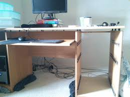 furniture board on top of computer desk drawers blocking 2 cam