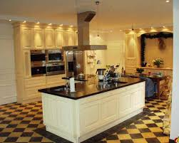 white kitchen cabinets with dark floors look perfect decor crave