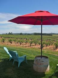 outdoor umbrella stand table what a fabulous diy idea for an outdoor umbrella table stand see