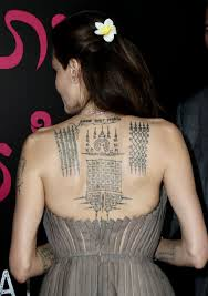 angelina jolie shows off massive back tattoo on the red carpet