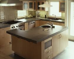 Kitchen Countertop Material by Small Kitchen Designed With Concrete Countertops And Silver