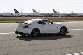 nissan 370z buyers guide feature flick 2014 nissan 370z nismo runs the standing mile