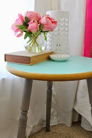 bedroom round turquoise nightstand with triple legs before the