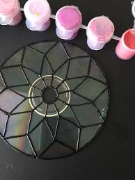 peel and paint a cd to put new spin on sun catchers catcher