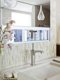Kitchen And Bathroom Designs See This Sophisticated Bathroom With A Striped Tile Shower