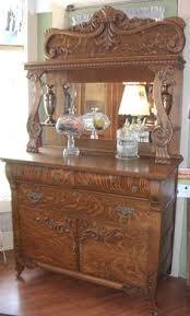 antique quartersawn oak carved griffins beveled mirror sideboard