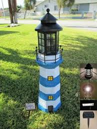 solar powered lighthouse lawn ornaments outsidemodern