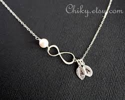 infinity necklace with initials personalized vertical infinity necklace two initial leaf and