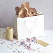 present tissue paper deluxe gift bag gift tag tissue paper and petals by the letter
