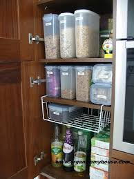 kitchen food storage cupboard before and after how i organised my food cupboard