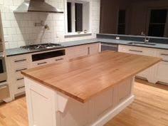 butcher block cutting board top kitchen island in white finish