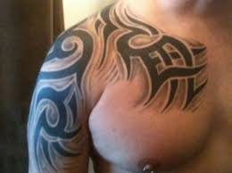 tribal shoulder and chest tattoo 2015