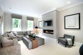 contemporary fireplace designs with tv above by modern house architects