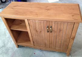 best spray paint for cabinet hinges how to spray paint furniture cabinet makeover bob vila