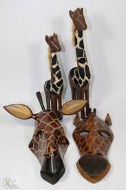 4 wooden giraffe ornaments