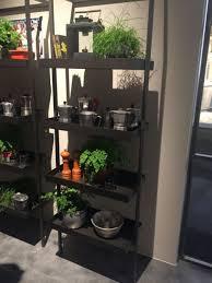 black metalic free standing kitchen shelves indoor plant pots