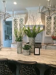 kitchen island centerpieces fantasy brown quartzite with white cabinets visit globalgranite com