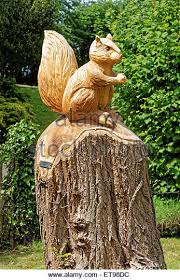 wood carving in garden stock photos wood carving in garden stock