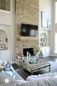 white birch realstone tile two story fireplace silver dollar