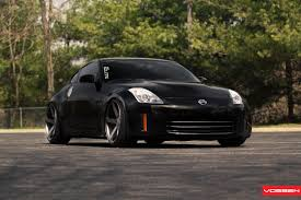 black nissan black nissan 350z dropped on colormatched vossen rims with deep