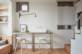 renovation turns drab tiny apartment into chic efficient home