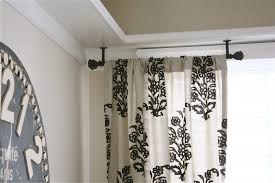 image of simple curtain rods for bay windows curtains in angled