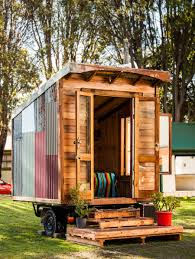 a tiny house mounted to a box trailer and made from 95 recycled