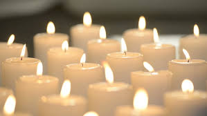 edited dolly of white candles burning with soft