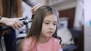 pictures of salon hairstyles for 8 yr old girl young happy boy laughing casually while eating candid shot of 8
