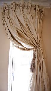 embroidery at top and along side curved curtain rod very full