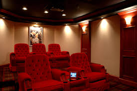 red sofas on the wooden floor luxury home theater design with warm