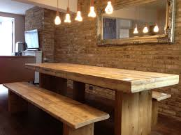 simple oak dining table and bench with recycled timber industrial