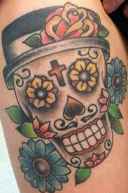 flowers and sugar skull tattoo on back