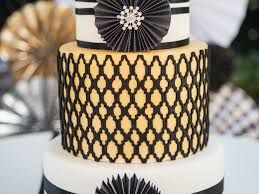 black white and gold wedding cake incorporating the paper wheels