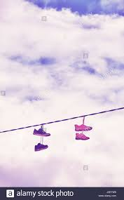 old shoes hang on wire color toning applied stock photo royalty