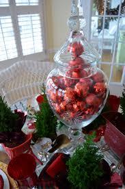 santa themed tablescape with santa plates and a sleigh centerpiece
