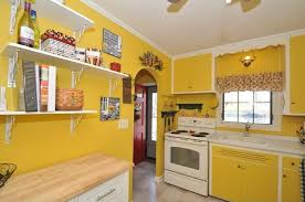 Yellow Kitchen With White Cabinets - cottage kitchen with crown molding u0026 wood counters in west allis